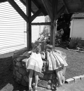 Hannah and Isabel making some GIANT wishes at the wishing well!