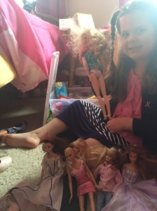 Izzy and her barbies.  She has a bald cancer Barbie, as you do.