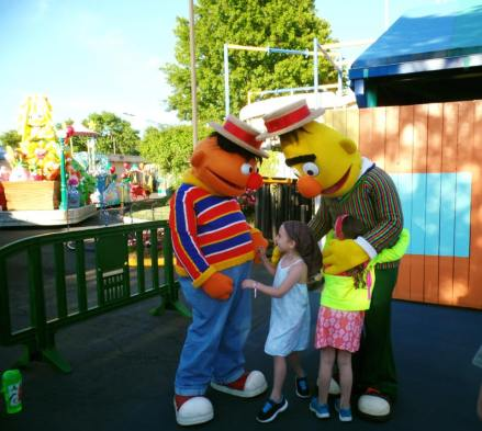 I just love this picture of Hannah and Izzy loving on Ernie and Bert.