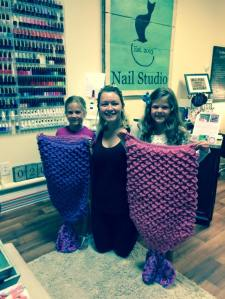 Emily with the girls and their blankets.